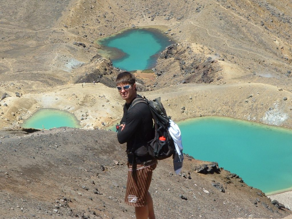 Picture of Travis Taylor, registered nurse, hiking. Lakes in background.